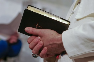 Man in popes garment holding holy bible. Adobe RGB for better color reproduction.
