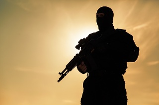Silhouette of special forces operators with weapons