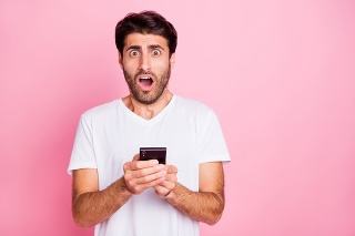 Portrait of negative addicted shocked funky middle eastern man hold use smartphone, read got notification dislike scream omg unbelievable expression wear style clothes isolated pastel color background
