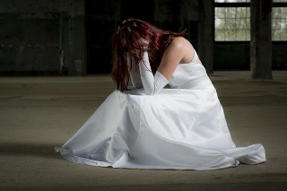 young bride sitting with her hands in her hair before the wedding