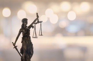 Justice law legal concept. statue of justice or lady justice with bokeh background.