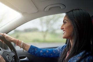 Shot of an attractive young woman driving her car