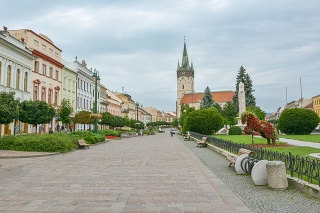 Presov, Slovakia - August 13, 2014: People walking on main street in the center of Presov in Slovakia during cloudy day in summer 2014