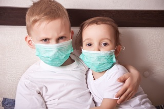 Boy and girl, a children in a medical mask. The concept of an epidemic, influenza, protection from disease, vaccination