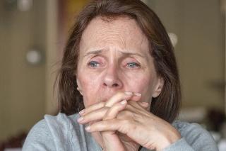 sad caucasian senior woman looking away