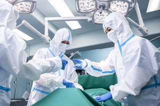 Doctors operating patients infected with covid-19