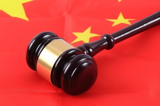 Gavel on Chinese flag, Chinese law