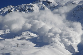 Dry snow avalanche with a powder cloud close to the village Terskol, Elbrus region