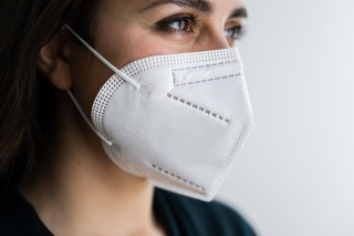 Receptionist Woman In Medical FFP2 Face Mask