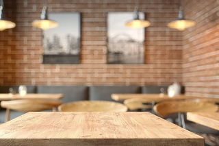 Empty tabletop in the coffe shop over defocused background with copy space