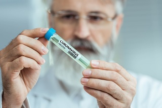 Scientist holding test tube with Coronavirus vaccine