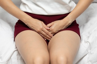 woman have bladder pain and stomach ache sitting on bed in bedroom after wake up feeling so sick and painful,Healthcare concept