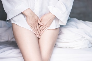 woman hand holding her crotch suffering from pain,itchy concept background