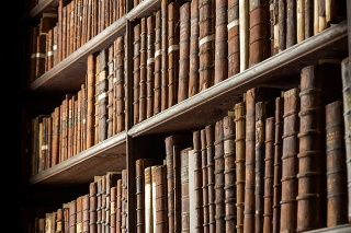Vintage library with shelves of old books.