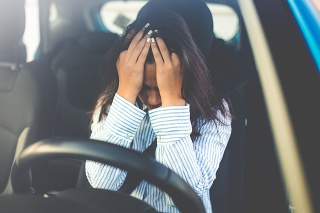 Cropped shot of a young woman looking stressed-out while sitting in her car. Stressed woman driver. Transportation concept. Sad businesswoman driver sitting in car