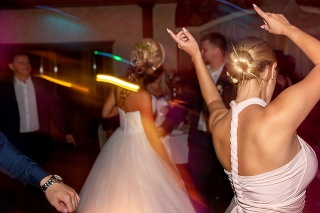 Wedding party. Guests and bridesmaids having fun and dancing on wedding banquet