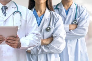 Telehealth, telemedicine doctor teamwork, surgeon, ER surgery team working in hospital medical clinic office diagnostic examining on patient care operation, professional teleclinic service