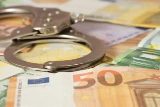 Handschellen und Euro Geldscheine