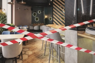 Quarantine Zone Warning Tape, Do Not Cross Concept. Red and white hazard safety stripes across empty closed restaurant