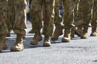 Feet of soldiers marching at an ANZAC Day parade on the streets of a regional country town