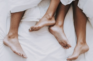 Young Beautiful Couple in Underwear Lying on Bad. Hadsome Man and Attactive Woman in Love. Passionate Romantic Couple Resting after Sax at Home. Passion Intimate Relationship and Love.