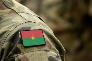 Flag of Burkina Faso on military uniform. Army, troops, soldiers, Africa, (collage).