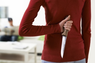 couple conflicts with woman holding knife and looking at husband