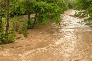 Turbulent river flooding the rainy forest