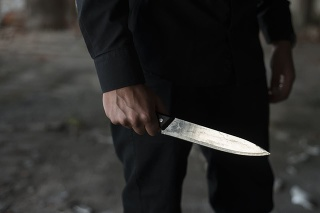 man holding knife in his hand