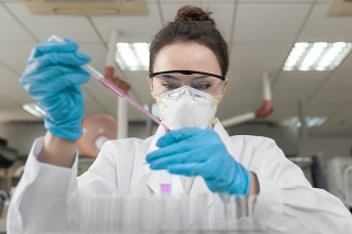 Female scientist working in the CDC laboratory.