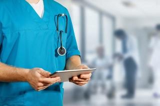 Concept of global medicine and healthcare. Doctor holds digital tablet. Diagnostics and modern technology