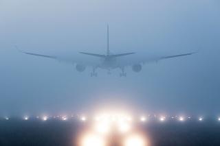 Airplane landing in fog
