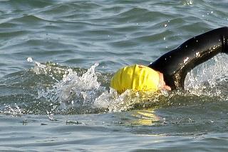 ocean swimming triathlon pair duel english channel duathlon biathlon wetsuit neoprene swim cap goggles waves ripples blue aqua
