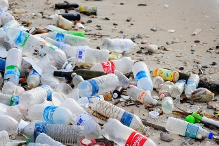 Kota Kinabalu, Malaysia - March 16, 2016: Garbage and plastic bottles on a beach left in Kota Kinabalu beach in Sabah Borneo, Malaysia. Just like many Asian countries, Malaysia have problems with waste management due to ignorance and low awareness.