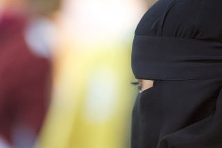 Portrait of a middle eastern woman wearing a black Niqab.