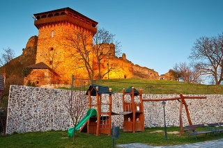 Filakovo, Slovakia - March 22, 16: Remains of a medieval castle in the town of Filakovo, southern Slovakia. Image was taken from a yard of a nearby guesthouse.