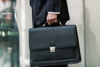 Leather briefcase held by a man.