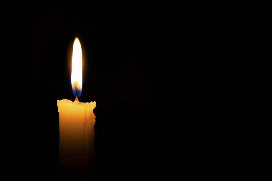 Single lit candle with