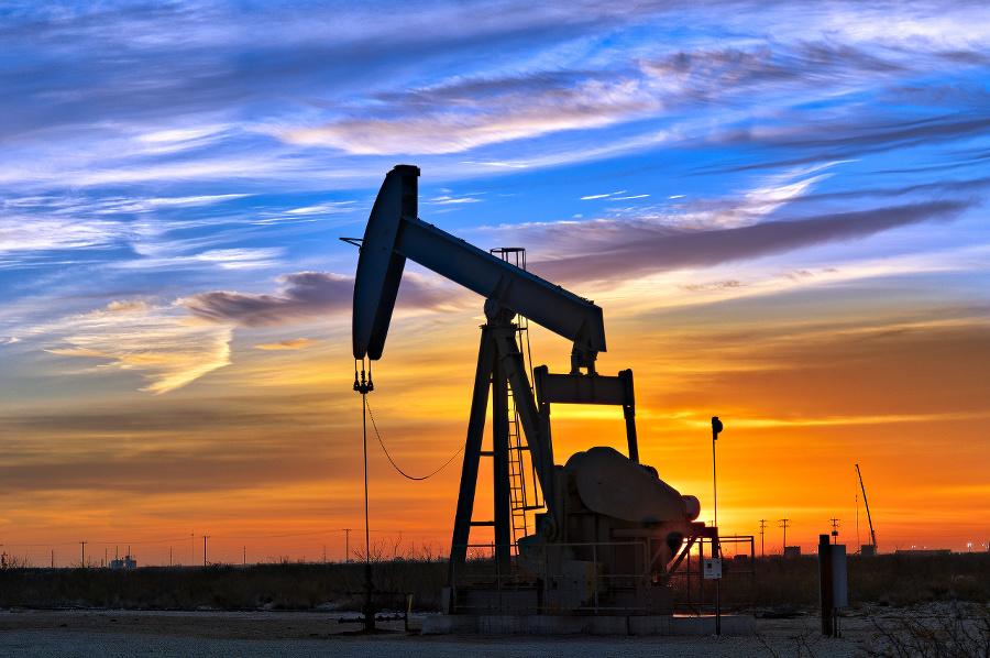 Dawn over petroleum pump.