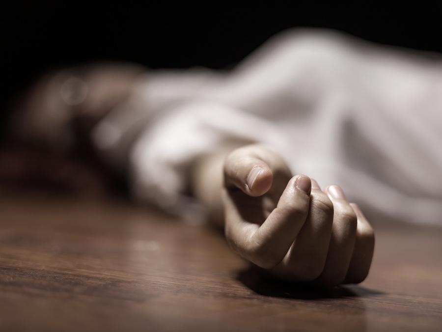The dead woman's body.