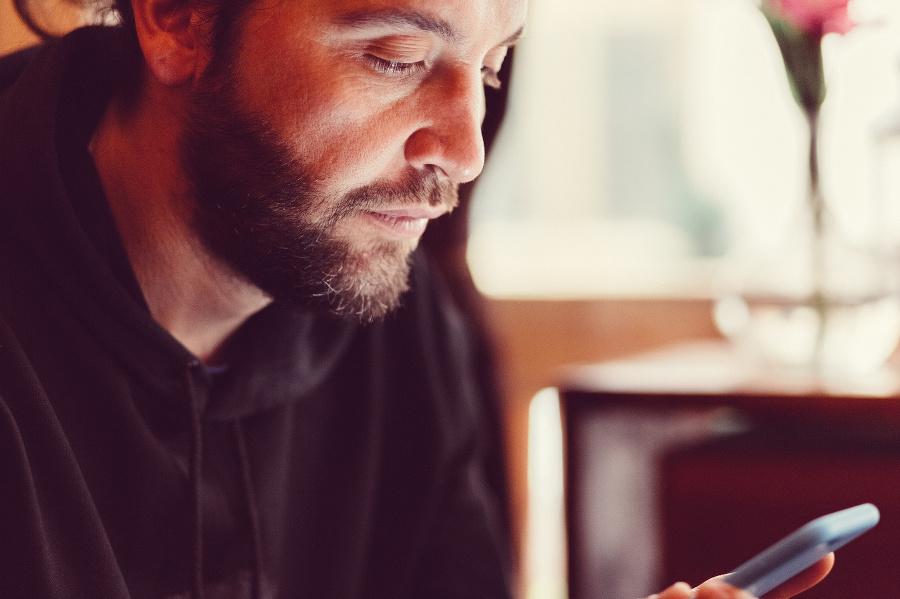Hipster man text messaging
