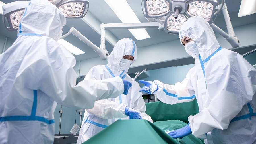 Doctors operating patients infected