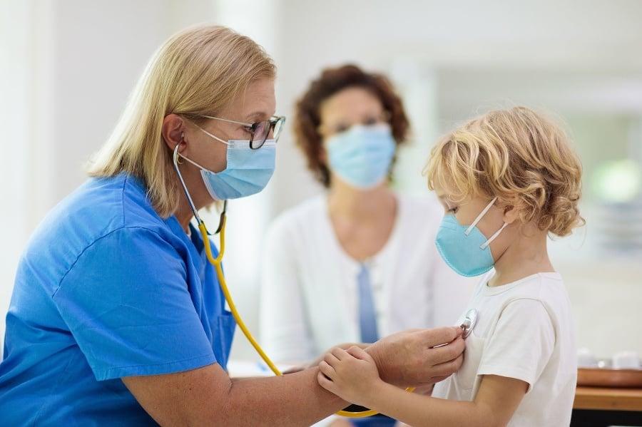Pediatrician doctor examining sick