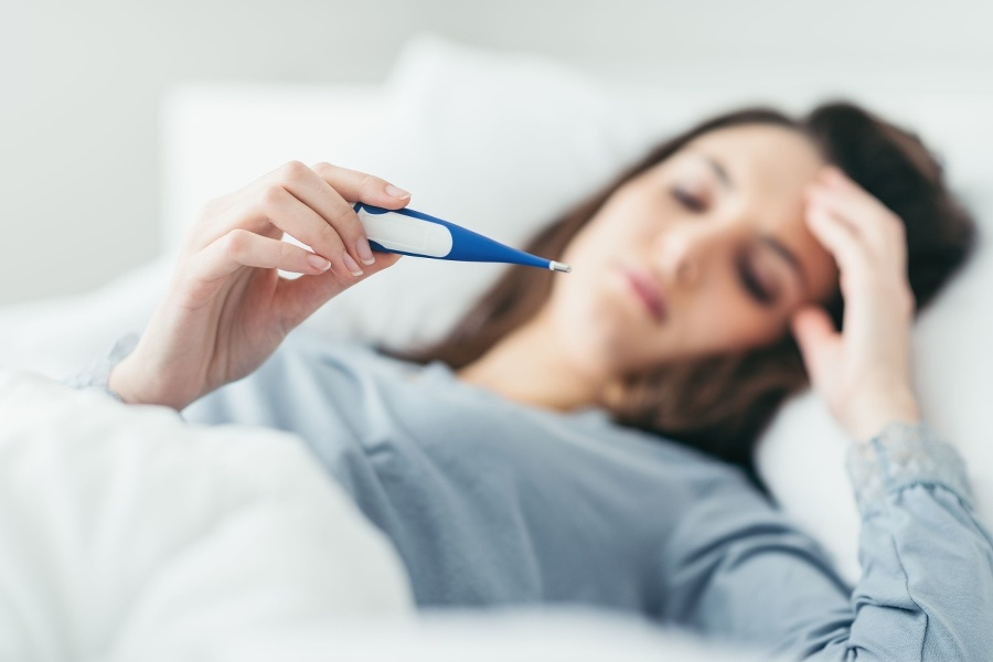 Woman with flu virus