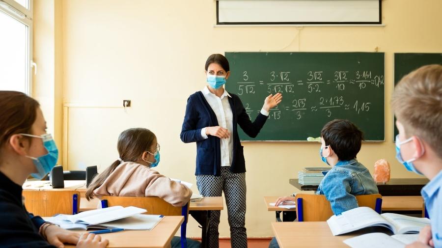 A teacher wearing a