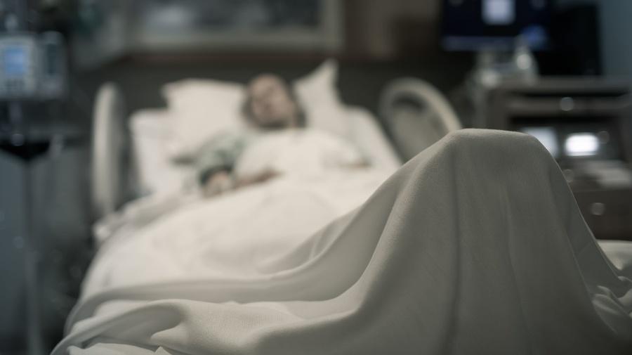 Sick woman lying in