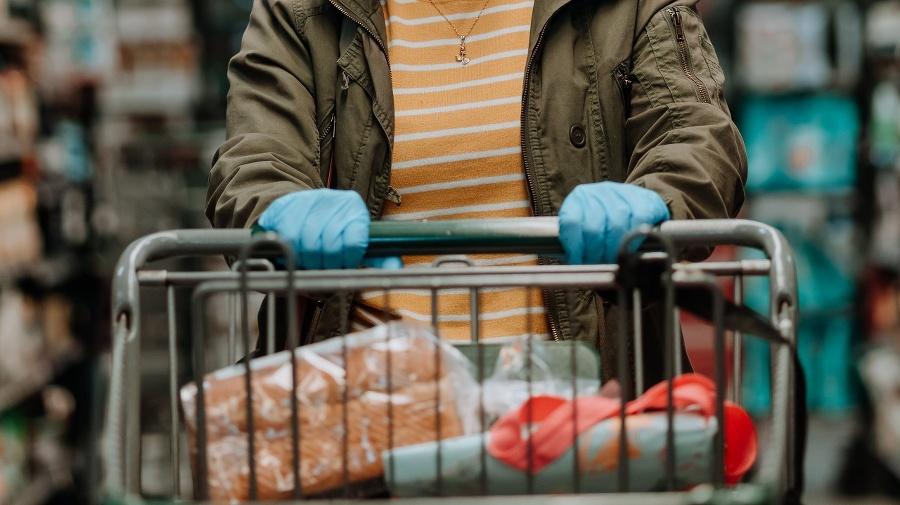 Woman pushing supermarket cart