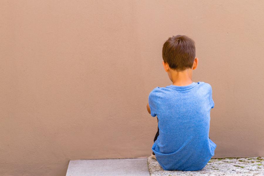 Sad alone boy sitting