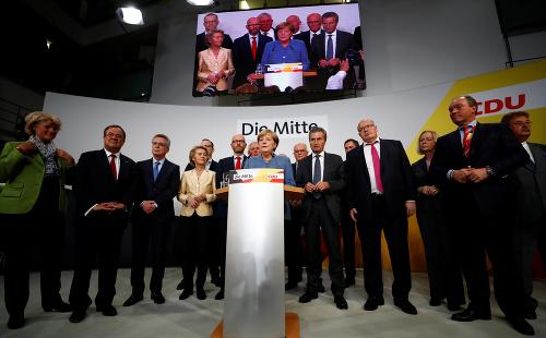 Angela Merkelová oslavuje víťazstvo.